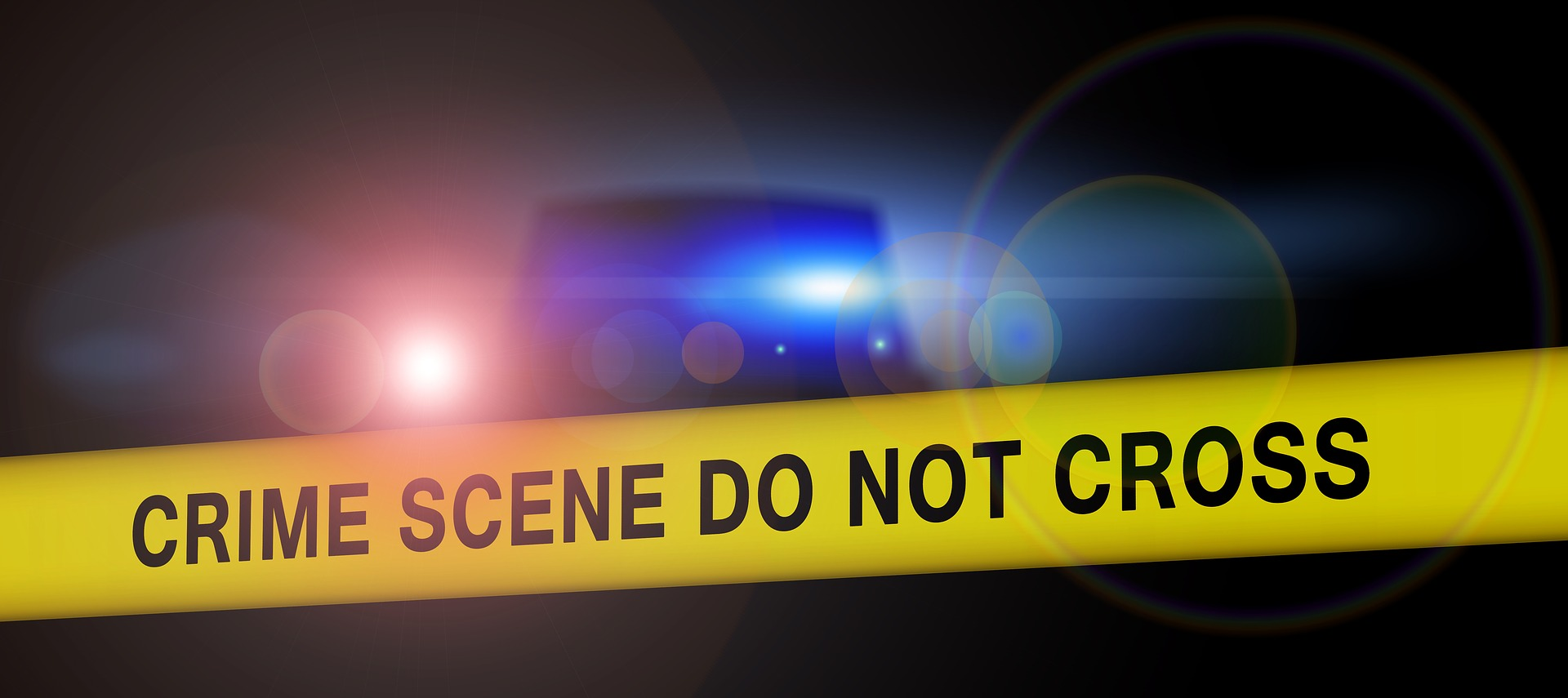 Crime scene tape and lights at scene of death